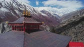 山頂 : Wonderful panorama, red pagoda at highlands, white snowy Tilicho Peak, Nepal 動画素材