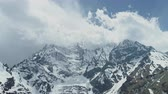 山頂 : Majestic clouds hiding sky-high peak of snow cold giant mountain Annapurna III 動画素材