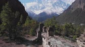 muren : Forest trekking path near buddhist Mani wall lead to snow mountain Annapurna II