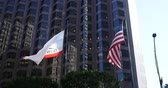 honra : California Republic and United States Flags are waving with the wind in San Francisco Finnancial building
