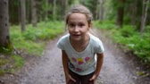выглядывал : Little girl child in summer forest running to the camera, stopping talking to you and showing welcoming gesture inviting to run together