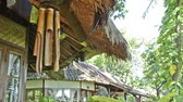 bambu : bamboo wind chime at a bungalow in indonesia in wind