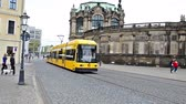 walking : Dresden, Germany - April, 25. 2014: panning with tram in Dresden, Germany. In the background the Zwinger, right the Hofkirche. The tram drives  over the Theaterplatz.