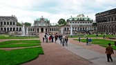 walking : Dresden, Germany - April, 25. 2014: Dresden Zwinger - the famous historic building in the city in Germany. People walking around. Stock Footage