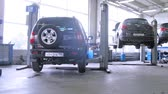 carcare : MOSCOW - AUG 27: (Timelapse View) New cars stand in service center of Automobile Dealership Automir, on on Aug 27, 2012 in Moscow, Russia. 17 Automobile Dealership Automir are in Moscow Stock Footage