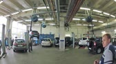 carcare : MOSCOW - AUG 27: (Timelapse View) Cars stand in garage of service center of Automobile Dealership Automir, on on Aug 27, 2012 in Moscow, Russia. Automir represents 21 leading automobile brands