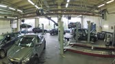 carcare : MOSCOW - AUG 27: (Timelapse View) Two cars are fixed on lifting-jack hoist in garage of Dealership Automir, on Aug 27, 2012 in Moscow, Russia. Automir represents 21 leading automobile brands Stock Footage