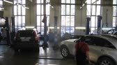 carcare : MOSCOW - AUG 22: (Timelapse View) Cars stands in garage of service center Avtostandart, on Aug 22, 2012 in Moscow, Russia Stock Footage