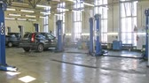 carcare : Cars stands in garage of service center, time lapse
