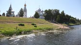 vários : Vologda river bank with bathing people, trees and several temples of Vologda Kremlin