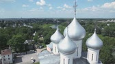 Saint Sofia cathedral among forest in Vologda, Russia Vídeos