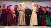 MOSCOW - NOVEMBER 4: Slava Zaitsev goes to the podium with his models at a charity fashion show for orphans and disabled children on November 4, 2011 in Moscow, Russia