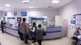 пост : MOSCOW - OCT 3: (Timelapse) People in line in post office at working day, on Oct 3, 2012 in Moscow, Russia. Russian Post is a founding member of the Universal Postal Union