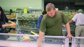 refrigerated : man buying food stuff in supermarket