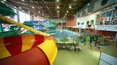 waterworks : Adults and children bathe in a big pool with a fountains in indoor water park