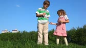 energy : kids openning bottles with yoghurt and drink outdoors Stock Footage