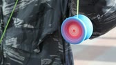 yoyo : young man keeps yoyo on string, and it is rapidly spinning
