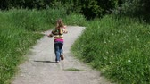 little : Little girl running by country road