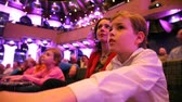 interior : mother with son and daughter sits on spectators seats in theater interior Stock Footage