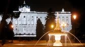 ildefonso : Fountain stands in front of king palace at night, time lapse