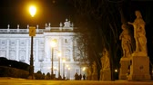 ildefonso : People walk on square Plaza de Oriente near king palace in evening, time lapse