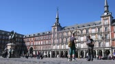 latão : MADRID - MAR 9: (Timelapse View) Tourists walk on Plaza Mayor near statue of king Philippe III, on Mar 9, 2012 in Madrid, Spain. In 1848 by order of queen Isabella II statue placed into square