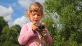 снимок : little girl with photo camera outdoor