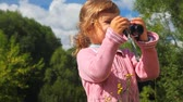 снимок : little girl with photo camera in park