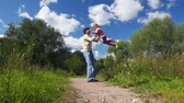 paternidade : father rotating with daughter outdoor