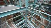 construir : multilevel interior of factory with escalators and ladders