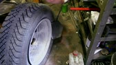 shrink : Man put off tyre from car wheel by special tool, closeup view Stock Footage