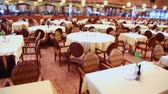 clothe : Many chairs and tables in empty restaurant, around motion Stock Footage