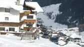 remover : SOELDEN - FEB 17: (Timelapse View) Hotel Gruenerhof stands in valley on mountain slope shined by sun, on Feb 17, 2012 in Soelden, Austria