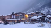 remover : Hotel stands near road  in valley where cars go and ly snow, time lapse Vídeos