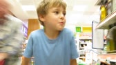 little : Child in the shop. Time lapse Stock Footage