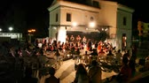 nézett : CALABRIA, ITALY - JULY 22: Girls from animation team entertain tourists at hotel CLUB BELLERIVE in evening on July 22, 2010 in Calabria, Italy. Italy annually visit by more than 43.2 million tourists