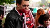 camarada : MOSCOW - MAY 14: Bloody zombies youth closeup at background of city during Zombie Parade on May 13, 2011 in Moscow, Russia Stock Footage