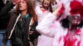 camarada : MOSCOW - MAY 14: Bloody newlyweds walk among crowd of zombies during Zombie Parade on May 13, 2011 in Moscow, Russia Stock Footage