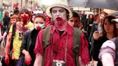 camarada : MOSCOW - MAY 14: Bloody zombies walk among people on street at summer day on May 13, 2011 in Moscow, Russia