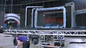marco internacional : MOSCOW - DEC 17: (Timelapse View) Working scenes haul down downwards projector as to dismantle, on concert of Legend RetroFM in Sports complex Olimpiyskiy, on Dec 17, 2011 in Moscow, Russia