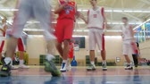 corner : MOSCOW - DECEMBER 9: Men play basketball in Russian State University of Physical Education, December 9, 2010 in Moscow, Russia. Numerous variations of basketball have developed for casual play.  Stock Footage