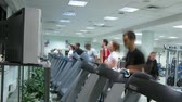 trotting : MOSCOW - OCT 11: People watch TV on treadmills at Multisport fitness club, Oct 11, 2010 in Moscow, Russia. Running on treadmills is easier than running on an equivalently flat distance outdoors. Stock Footage