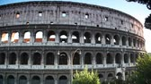 Colosseum or Flavian Amphitheatre in Rome, view from passing bus
