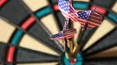 bull ring : Three arrows with American flag hit bullseye on dartboard, closeup view Stock Footage
