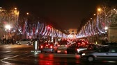 comemorativo : PARIS - DECEMBER 29: many cars traveling at crossroads of Champs-Elysees avenue to Arc de Triomphe at night on December 29, 2009, Paris, France. Arc de Triomphe is linchpin of historic axis