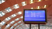 пиктограмма : electronic information board under arched ceiling of airport