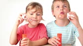 juntar : Two kids boy enjoy blows soap bubbles they, are very happy