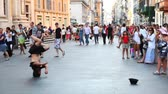 life : ROME - AUGUST 4: Guy is spinning on his head in city center on August 4, 2010 in Rome, Italy. Breykdens ( Breakdance) - street dance style that evolved from hip-hop movement in New York in early 70s. Stock Footage