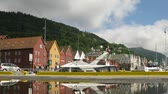 tornar : BERGEN, NORWAY- JUNE 27: Old Hanseatic district Bryggen on June 27, 2011 in Bergen, Norway. Bryggen is one of popular cultural sites which recently become available in 3D on Google Earth.