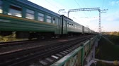 cabine : Train passes by on railway bridge, at sunny summer day Stock Footage